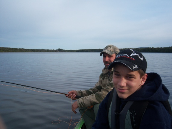 Dad and son fishing in the canoe..Mom in the front (c) S. Warren