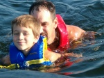 Dad and little Ty swimming in the lake